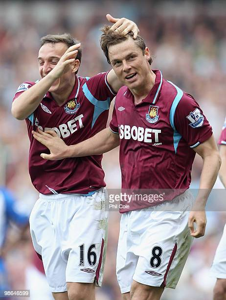 Scott Parker of West Ham celebrates with teammate Mark Noble after scoring the third goal during the Barclays Premier League match between West Ham...