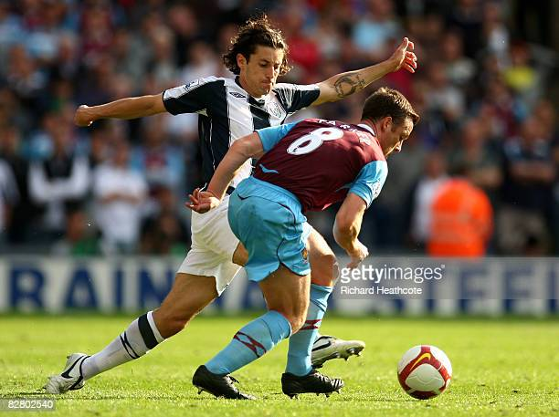 Scott Parker of West Ham challenges Robert Koren of Albion during the Barclays Premier League match between West Bromwich Albion and West Ham United...