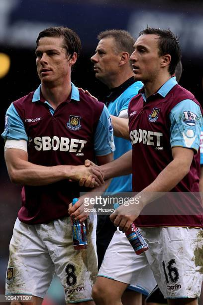 Scott Parker of West Ham is congratulated by teammate Mark Noble after the Barclays Premier League match between West Ham United and Liverpool at the...
