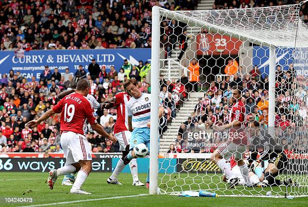 Scott Parker of West Ham scores the opening goal during the Barclays Premier League match between Stoke City and West Ham United at the Britannia...
