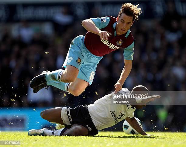 Scott Parker of West Ham tangles with Jermain Defoe of Tottenham during the Barclays Premier League match between Tottenham Hotspur and West Ham...