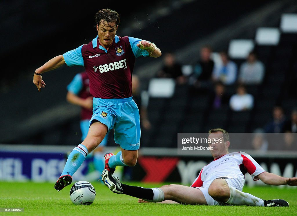 Scott Parker of West Ham United battles with <a gi-track='captionPersonalityLinkClicked' href=/galleries/search?phrase=Dietmar+Hamann&family=editorial&specificpeople=204639 ng-click='$event.stopPropagation()'>Dietmar Hamann</a> of MK Dons during the pre-season friendly match between MK Dons and West Ham United at the Stadium MK on July 28, 2010 in Milton Keynes, England.