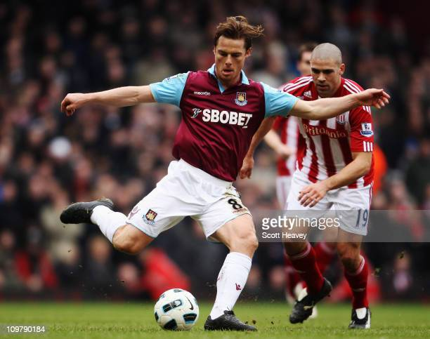 Scott Parker of West Ham United controls the ball during the Barclays Premier League match between West Ham United and Stoke City at the Boleyn...