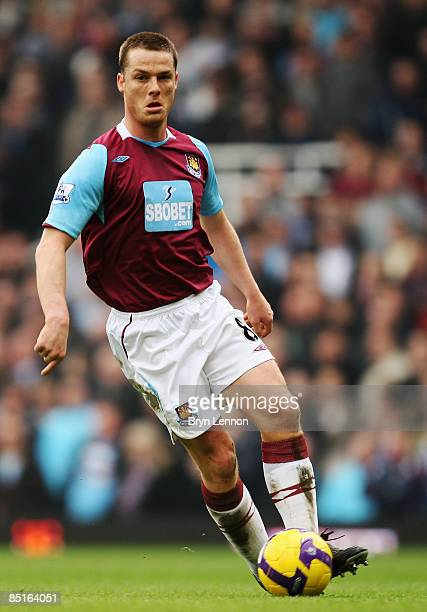 Scott Parker of West Ham United runs with the ball during the Barclays Premier League match between West Ham United and Manchester City at Upton Park...