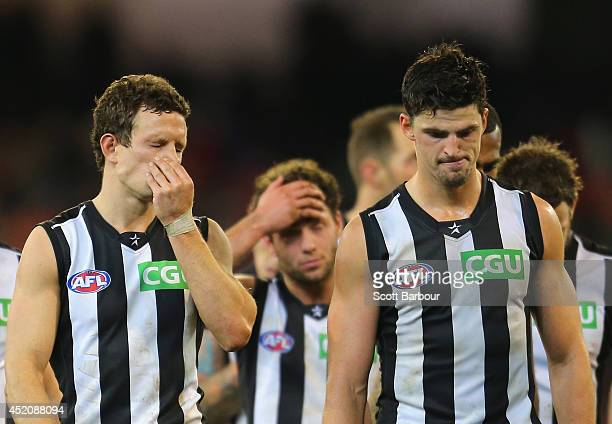 Scott Pendlebury and Luke Ball of the Magpies leave the field after losing the round 17 AFL match between the Essendon Bombers and the Collingwood...