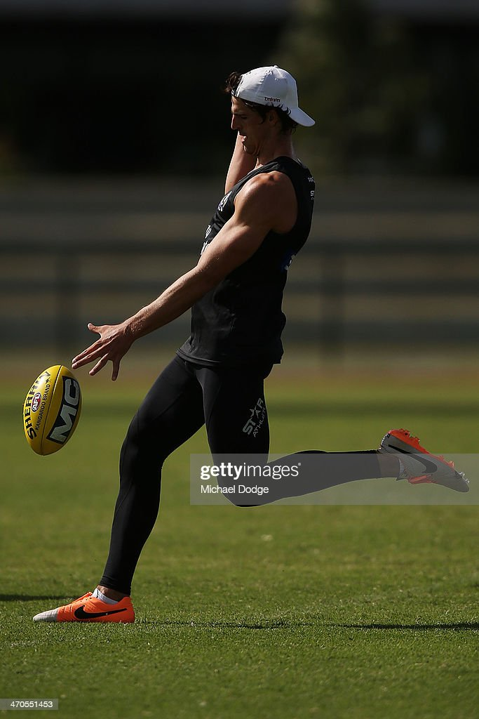 <a gi-track='captionPersonalityLinkClicked' href=/galleries/search?phrase=Scott+Pendlebury&family=editorial&specificpeople=585782 ng-click='$event.stopPropagation()'>Scott Pendlebury</a> kick the ball during a Collingwood Magpies AFL training session at Olympic Park on February 20, 2014 in Melbourne, Australia.