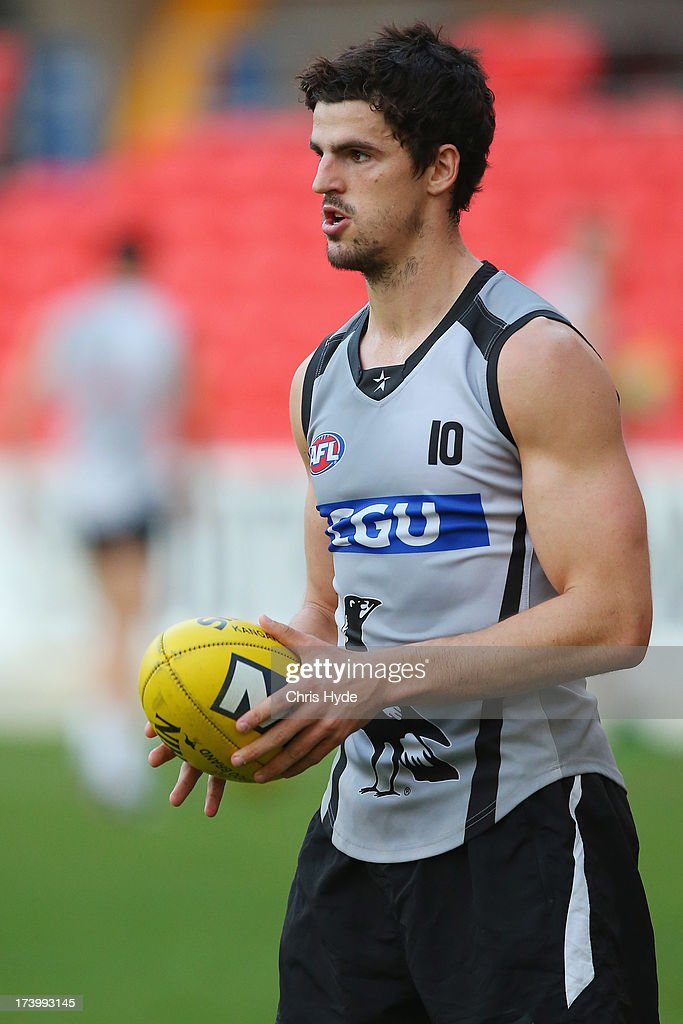 Scott Pendlebury looks on during a Collingwood Magpies AFL training session at Metricon Stadium on July 19, 2013 in Gold Coast, Australia.