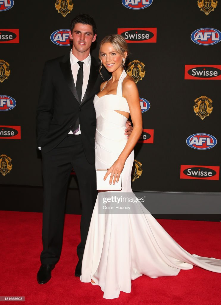 <a gi-track='captionPersonalityLinkClicked' href=/galleries/search?phrase=Scott+Pendlebury&family=editorial&specificpeople=585782 ng-click='$event.stopPropagation()'>Scott Pendlebury</a> of the Magpies and his partner Alex Davis arrive ahead of the 2013 Brownlow Medal at Crown Palladium on September 23, 2013 in Melbourne, Australia.