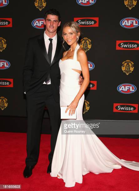 Scott Pendlebury of the Magpies and his partner Alex Davis arrive ahead of the 2013 Brownlow Medal at Crown Palladium on September 23 2013 in...