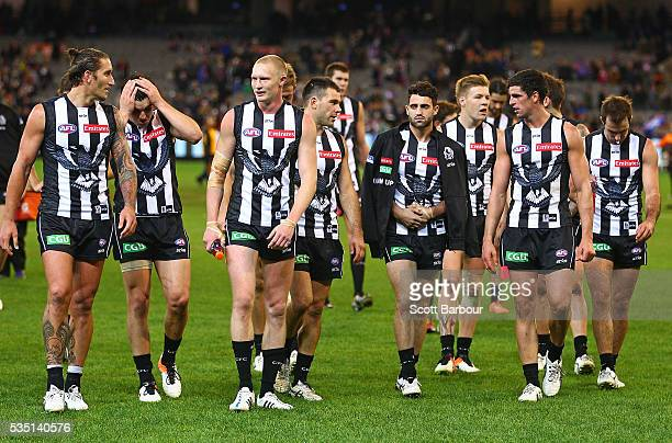 Scott Pendlebury of the Magpies and his teammates incuding an injured Alex Fasolo of the Magpies leave the field after they lost the round 10 AFL...