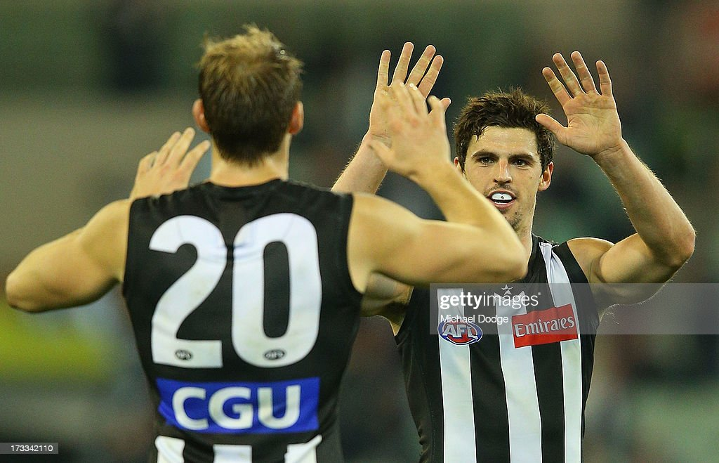 <a gi-track='captionPersonalityLinkClicked' href=/galleries/search?phrase=Scott+Pendlebury&family=editorial&specificpeople=585782 ng-click='$event.stopPropagation()'>Scott Pendlebury</a> (R) of the Magpies celebrates a goal with Ben Reid during the round 16 AFL match between the Collingwood Magpies and the Adelaide Crows at Melbourne Cricket Ground on July 12, 2013 in Melbourne, Australia.