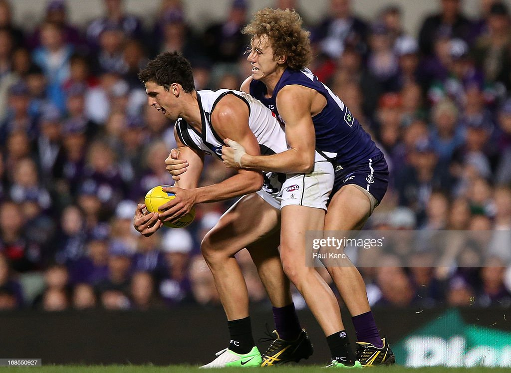 Scott Pendlebury of the Magpies gets tackled by Chris Mayne of the Dockers during the round seven AFL match between the Fremantle Dockers and the Collingwood Magpies at Patersons Stadium on May 11, 2013 in Perth, Australia.