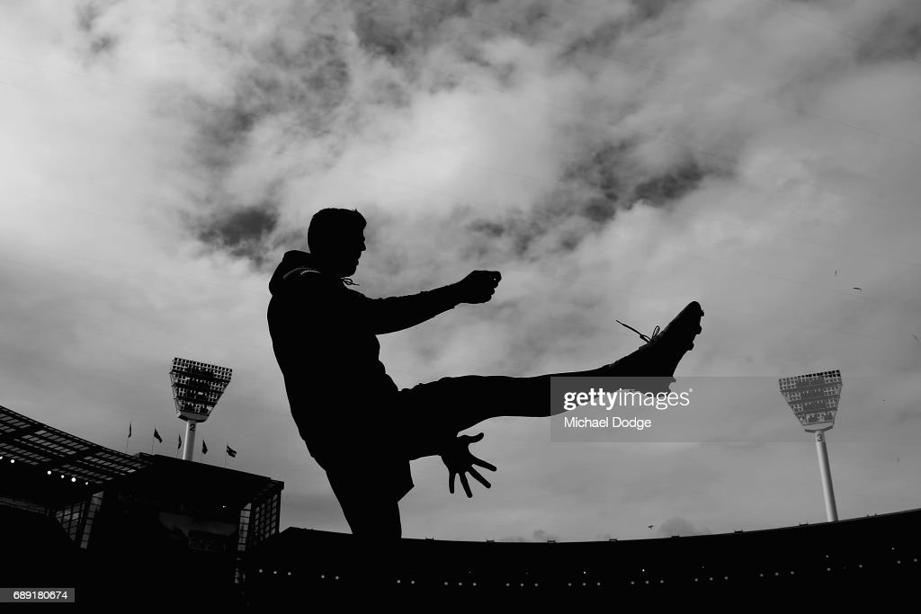 Scott Pendlebury of the Magpies kicks the ball before warm up during the round 10 AFL match between the Collingwood Magpies and Brisbane Lions at Melbourne Cricket Ground on May 28, 2017 in Melbourne, Australia.