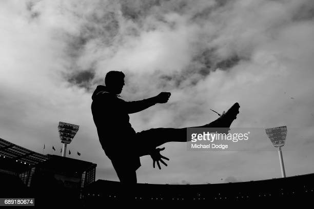 Scott Pendlebury of the Magpies kicks the ball before warm up during the round 10 AFL match between the Collingwood Magpies and Brisbane Lions at...
