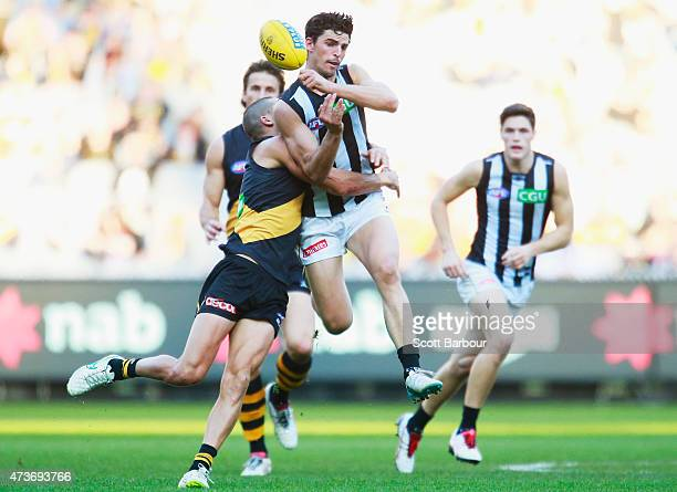 Scott Pendlebury of the Magpies passes the ball in a tackle during the round seven AFL match between the Richmond Tigers and the Collingwood Magpies...