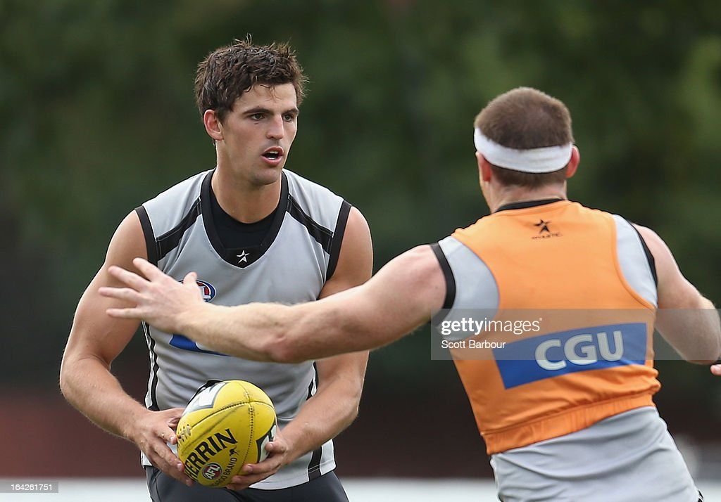 Scott Pendlebury of the Magpies runs with the ball during a Collingwood Magpies AFL training session at Gosch's Paddock on March 22, 2013 in Melbourne, Australia.