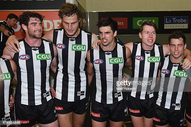 Scott Pendlebury of the Magpies sings the club song with team mates during the round eight AFL match between the Gold Coast Suns and the Collingwood...