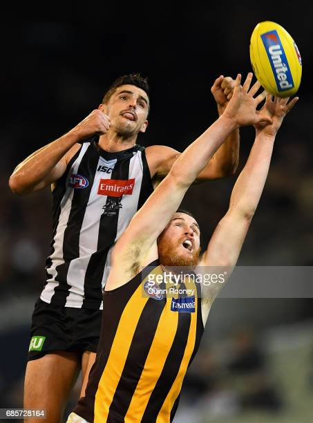 Scott Pendlebury of the Magpies spoils a mark by Jarryd Roughead of the Hawks during the round nine AFL match between the Collingwood Magpies and the...