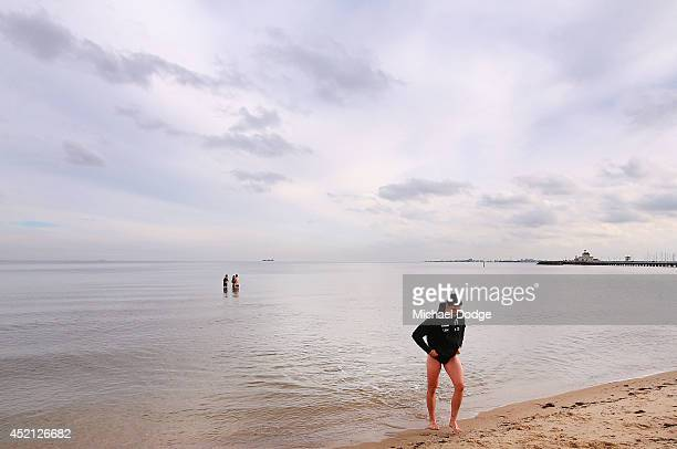 Scott Pendlebury of the Magpies walks out of the water during a Collingwood Magpies AFL recovery session at St Kilda Beach on July 14 2014 in...