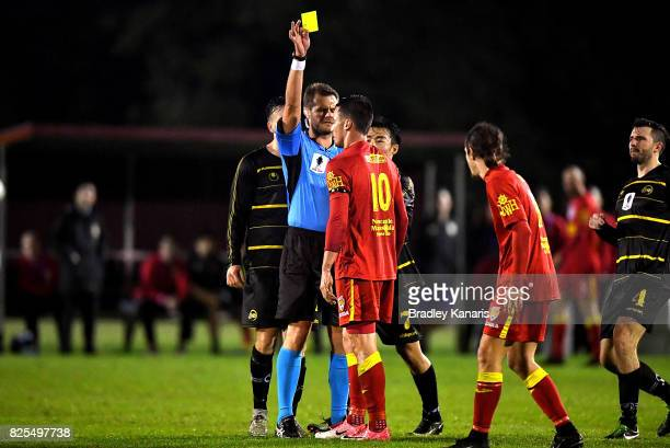 Scott Pettit of the Magic is given a yellow card during the FFA Cup round of 32 match between Moreton Bay United FC and Broadmeadow Magic at Wolter...