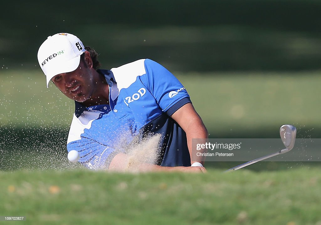 Scott Piercy hits a bunker shot onto the green during the final round of the Sony Open in Hawaii at Waialae Country Club on January 13, 2013 in Honolulu, Hawaii.