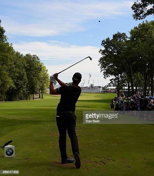 Scott Piercy hits a tee shot on the second hole during the final round of the BMW Championship at Conway Farms Golf Course on September 20 2015 in...