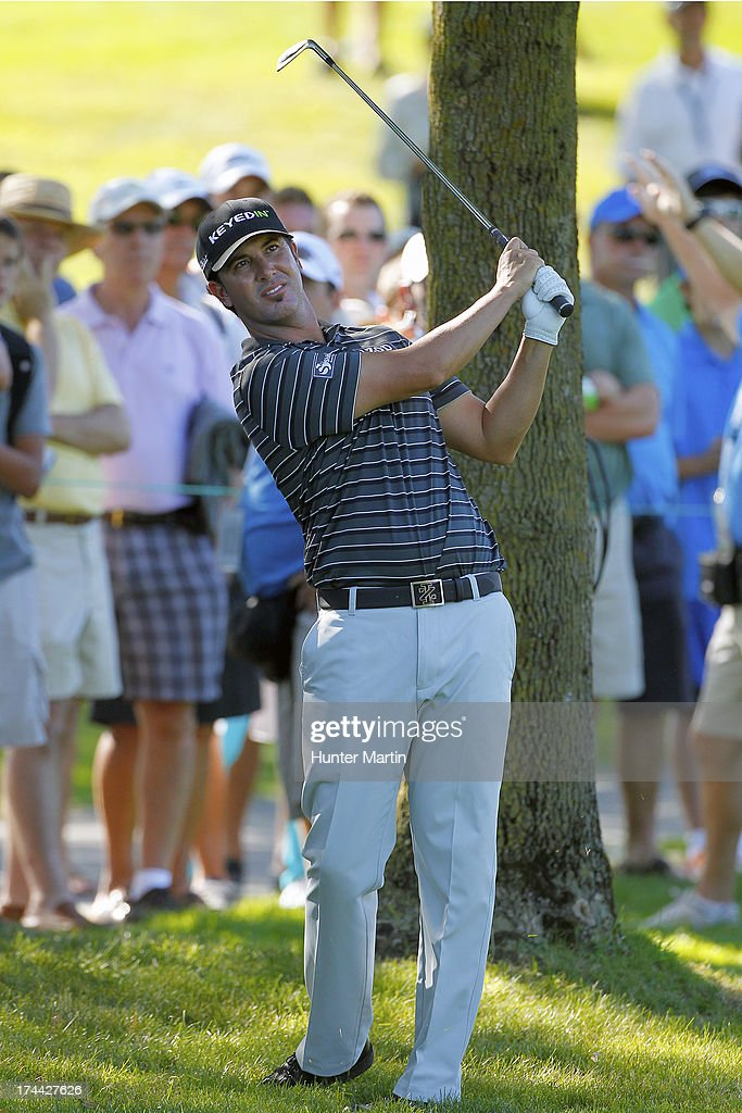 <a gi-track='captionPersonalityLinkClicked' href=/galleries/search?phrase=Scott+Piercy&family=editorial&specificpeople=4464716 ng-click='$event.stopPropagation()'>Scott Piercy</a> of the United States hits his second shot on the 16th hole during round one of the RBC Canadian Open at Glen Abby Golf Club on July 25, 2013 in Oakville, Ontario.