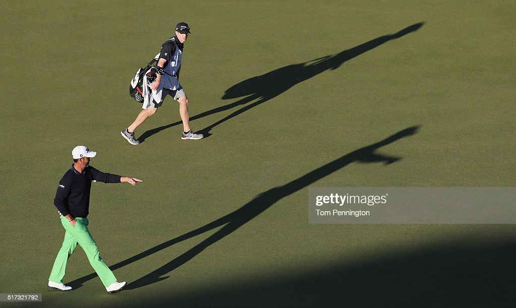 Scott Piercy of the United States walks with his caddie across the 16th green during the second round of the World Golf Championships-Dell Match Play at the Austin Country Club on March 24, 2016 in Austin, Texas.