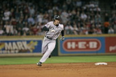 Scott Podsednik of the Chicago White Sox hits a triple in the 3rd inning during game 4 of the World Series against the Houston Astro's at Minute Maid...