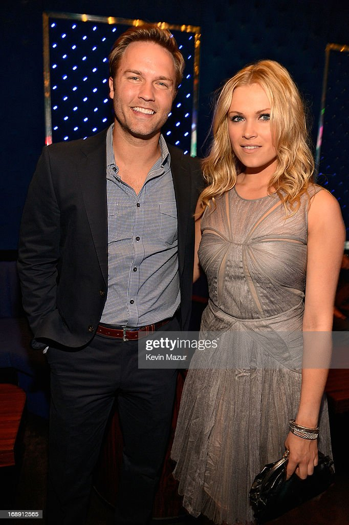 Scott Porter and Eliza Taylor attend The CW Network's 2013 Upfront party at FINALE on May 16, 2013 in New York City.