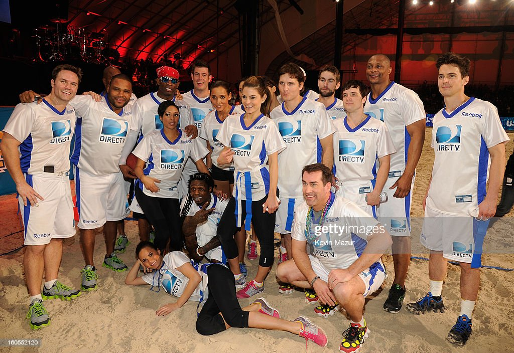 Scott Porter, Anthony Anderson, Deion Sanders, Alicia Quarles, Jesse Palmer, Lolo Jones, Maria Menounos, Peter Facinelli, Chace Crawford, Josh Hutcherson, Eddie George, Matt Bomer, (Bottom L-R) Chrissy Teigen, Lil Wayne, Rob Riggle attend DIRECTV'S 7th annual celebrity Beach Bowl at DTV SuperFan Stadium at Mardi Gras World on February 2, 2013 in New Orleans, Louisiana.