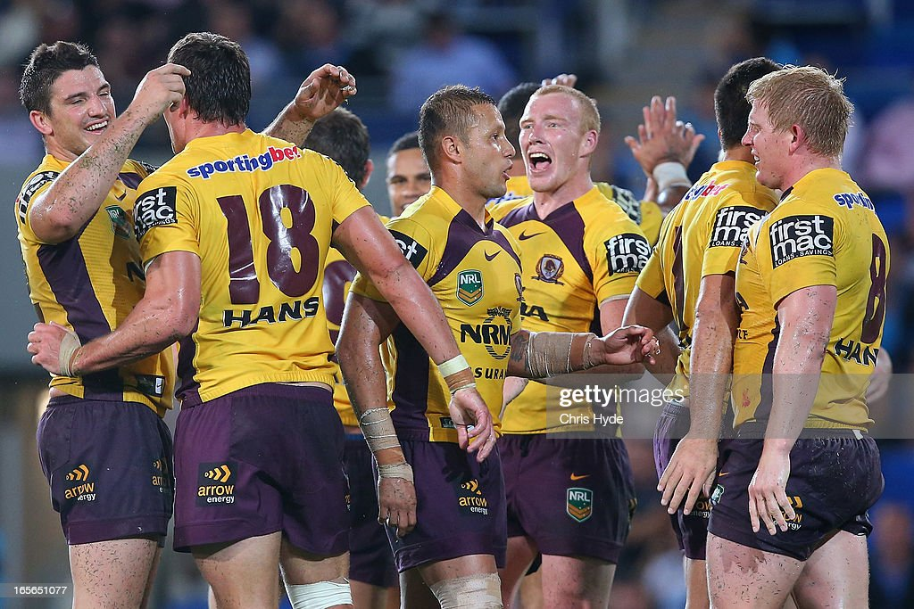 <a gi-track='captionPersonalityLinkClicked' href=/galleries/search?phrase=Scott+Prince&family=editorial&specificpeople=171862 ng-click='$event.stopPropagation()'>Scott Prince</a> and the Broncos celebrate winning the round five NRL match between the Gold Coast Titans and the Brisbane Broncos at Skilled Park on April 5, 2013 in Gold Coast, Australia.