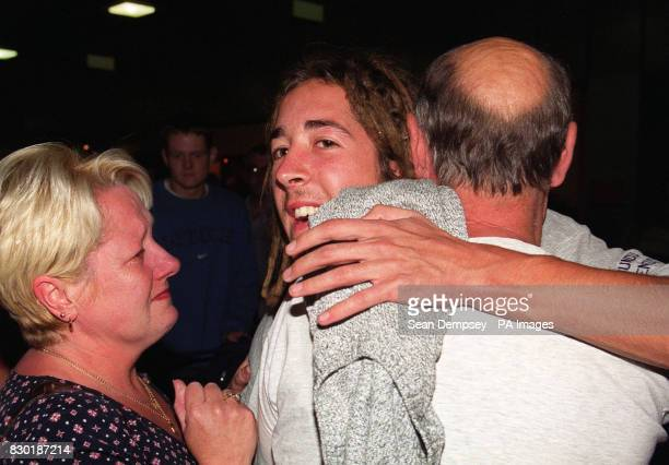 Scott Prince from Norfolk one of the survivors of a shipwreck in the South Pacific greets his parents Jackie and Billy at Heathrow Airport Prince and...