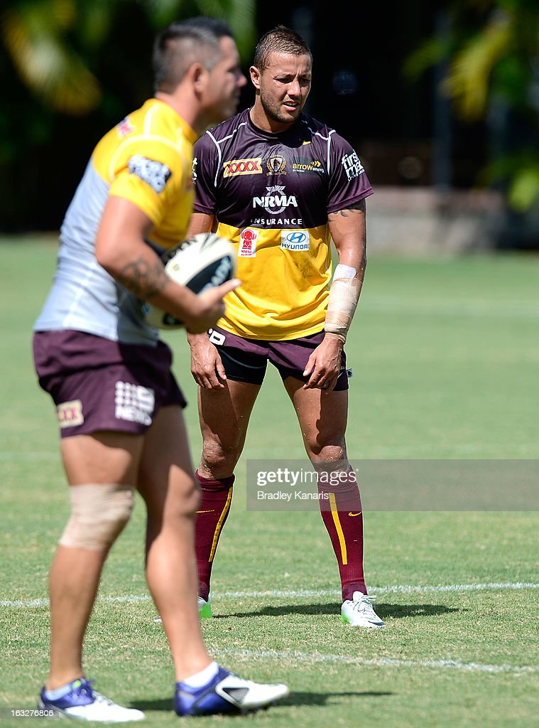 <a gi-track='captionPersonalityLinkClicked' href=/galleries/search?phrase=Scott+Prince&family=editorial&specificpeople=171862 ng-click='$event.stopPropagation()'>Scott Prince</a> lines up a kick for goal as team mate Corey Parker watches on during a Brisbane Broncos NRL training session on March 7, 2013 in Brisbane, Australia.