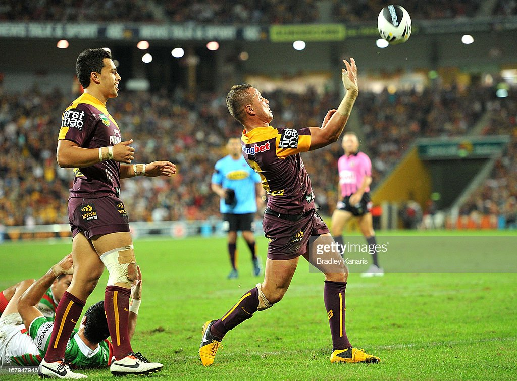 Scott Prince of the Broncos celebrates after scoring a try during the round eight NRL match between the Brisbane Broncos and the South Sydney Rabbitohs at Suncorp Stadium on May 3, 2013 in Brisbane, Australia.
