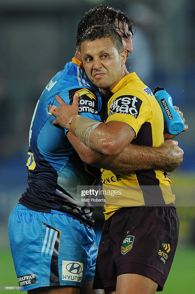 Scott Prince of the Broncos hugs david Taylor of the Titans after the round five NRL match between the Gold Coast Titans and the Brisbane Broncos at Skilled Park on April 5, 2013 on the Gold Coast, Australia.