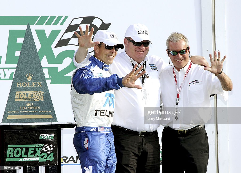 <a gi-track='captionPersonalityLinkClicked' href=/galleries/search?phrase=Scott+Pruett&family=editorial&specificpeople=541449 ng-click='$event.stopPropagation()'>Scott Pruett</a>, driver of the #01 <a gi-track='captionPersonalityLinkClicked' href=/galleries/search?phrase=Chip+Ganassi&family=editorial&specificpeople=224532 ng-click='$event.stopPropagation()'>Chip Ganassi</a> with Felix Sabates BMW Riley poses with team owner <a gi-track='captionPersonalityLinkClicked' href=/galleries/search?phrase=Chip+Ganassi&family=editorial&specificpeople=224532 ng-click='$event.stopPropagation()'>Chip Ganassi</a> and former chamion Hurley Haywood as five time winers of the Rolex 24 at Daytona International Speedway on January 27, 2013 in Daytona Beach, Florida.
