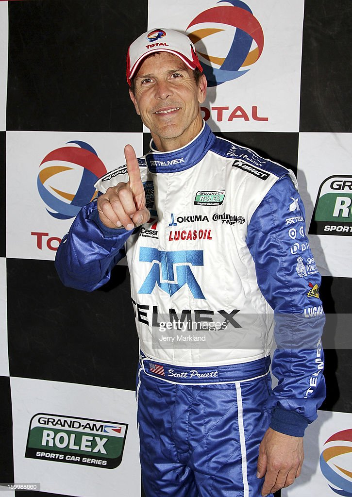 Scott Pruett, driver of the #01 TELMEX/Target BMW Riley, celebrates after winning the Pole position at Daytona International Speedway on January 24, 2013 in Daytona Beach, Florida.