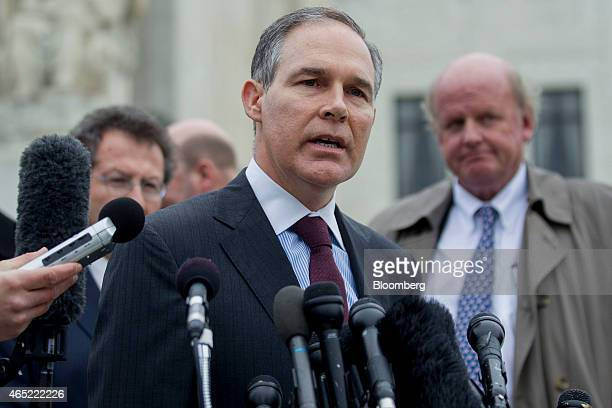 Scott Pruitt attorney general of Oklahoma center speaks to the media in front of the US Supreme Court with Michael Carvin lead attorney for the...