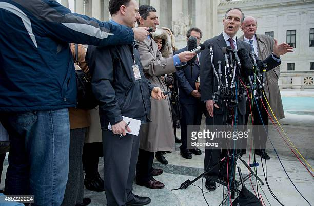 Scott Pruitt attorney general of Oklahoma second from right speaks to the media in front of the US Supreme Court with Michael Carvin lead attorney...