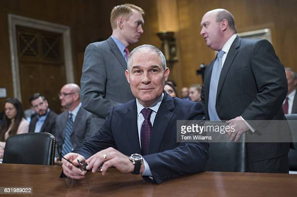 Scott Pruitt center Presidentelect Trump's nominee to be administrator of the Environmental Protection Agency arrives for his Senate Environment and...