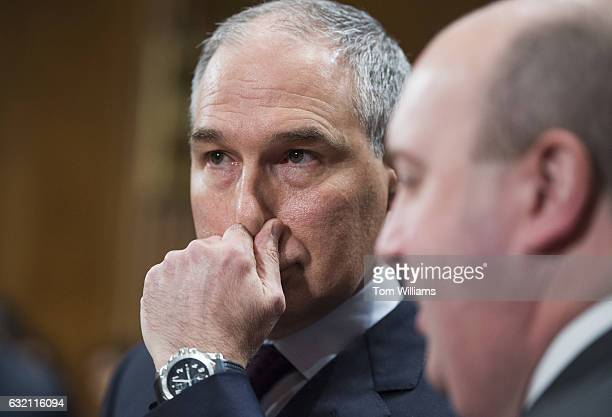 Scott Pruitt left President Trump's nominee to be administrator of the Environmental Protection Agency prepares for his Senate Environment and Public...