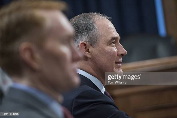 Scott Pruitt right President Trump's nominee to be administrator of the Environmental Protection Agency prepares to be introduced by Sen James...
