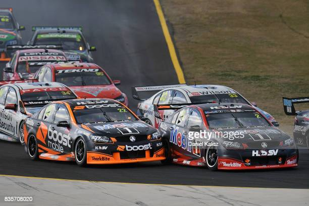 Scott Pye drives the Mobil 1 HSV Racing Holden Commodore VF makes contact with James Courtney drives the Mobil 1 HSV Racing Holden Commodore VF...