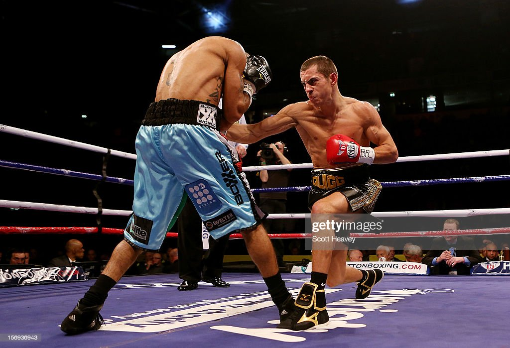 Scott Quigg (R) connects with Rendell Munroe during their Super Bantamweight bout at the MEN Arena on November 24, 2012 in Manchester, England.