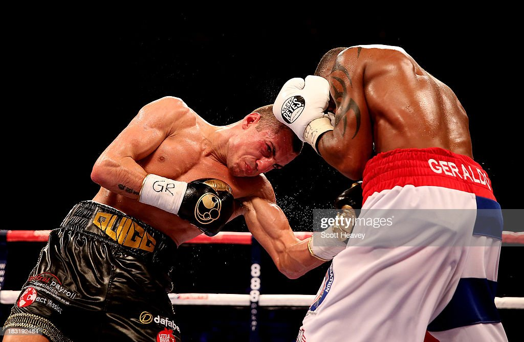 Scott Quigg (L) in action with Yoandris Salinas during their WBA World Super Bantamweight Championship bout at O2 Arena on October 5, 2013 in London, England.
