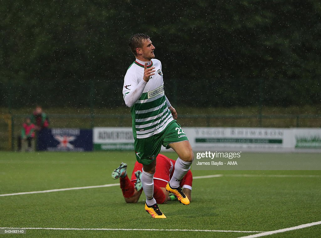 Scott Quigley of The New Saints celebrates after scoring a goal to make it 1-0 during the UEFA Champions League First Round Qualifier match between The New Saints and SP Tre Penne at Park Hall on June 28, 2016 in Oswestry, England.