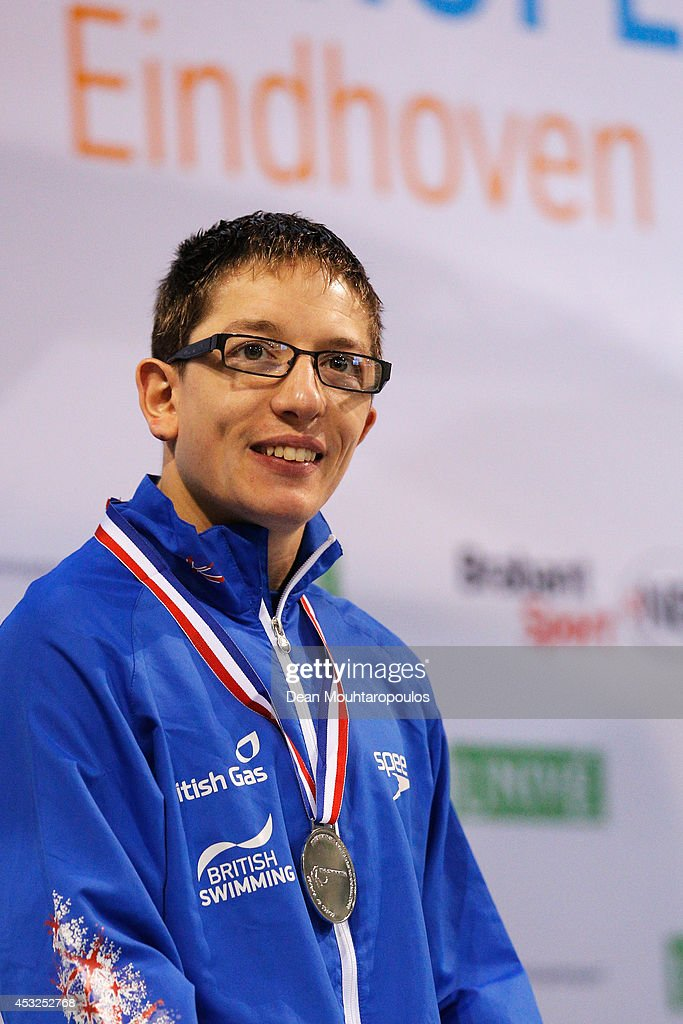 Scott Quin of Great Britain poses with his silver medal after his 2nd place in the Men's 100m Breaststroke SB14 Final during the IPC Swimming European Championships held at the Pieter van den Hoogenband Swimming Stadium on August 6, 2014 in Eindhoven, Netherlands.