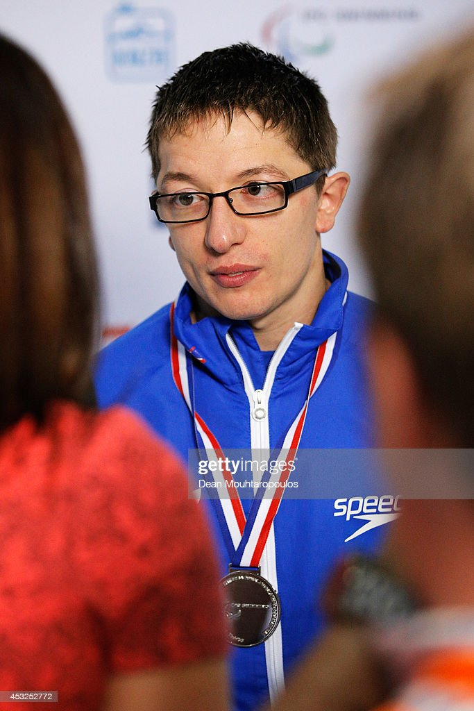 Scott Quin of Great Britain speaks to the media with his silver medal after his 2nd place in the Men's 100m Breaststroke SB14 Final during the IPC Swimming European Championships held at the Pieter van den Hoogenband Swimming Stadium on August 6, 2014 in Eindhoven, Netherlands.
