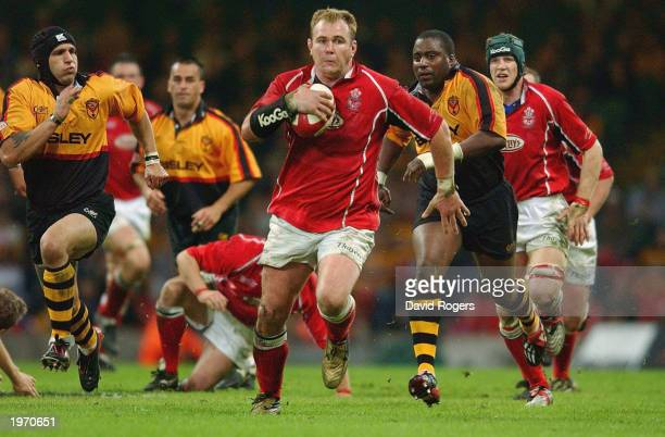Scott Quinnell the Llanelli number eight charges forward during the Principality Cup Final between Newport and Llanelli on May 3 2003 at the...